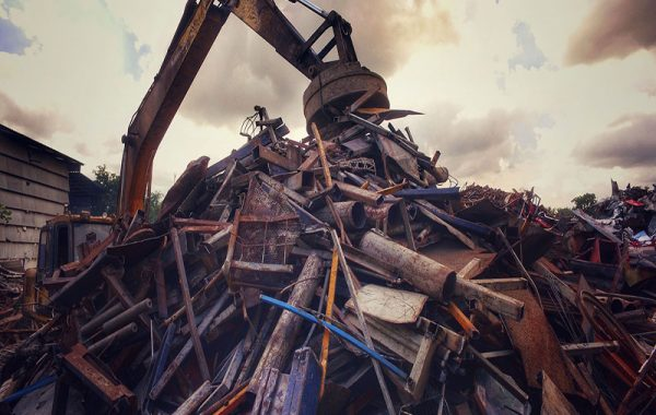 Crane handling scrap metal